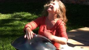 Renee LeBeau, Vibrational Sound Artist, playing a Pygmy Hang